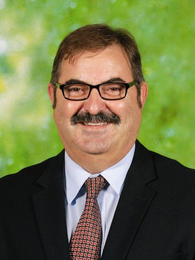 Mr Dennis Garoni